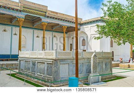 BUKHARA UZBEKISTAN - APRIL 29 2015: The large stone sarcophagus of Sheikh Naqshband with the scenic terrace on the background on April 29 in Bukhara.