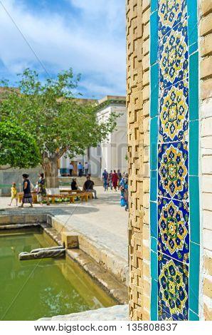 The floral islamic pattern on the glazed tile of Mausoleum of Sheikh Nakshband located in Bukhara suburb Uzbekistan.
