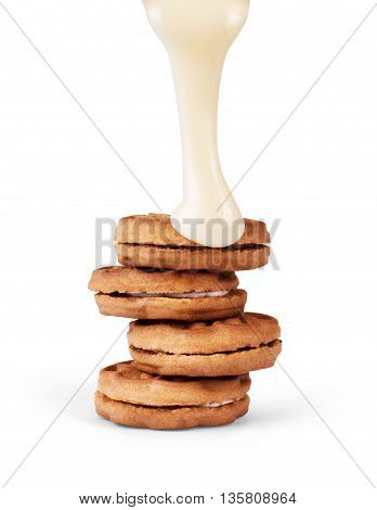 Cookie condensed milk poured on a white background