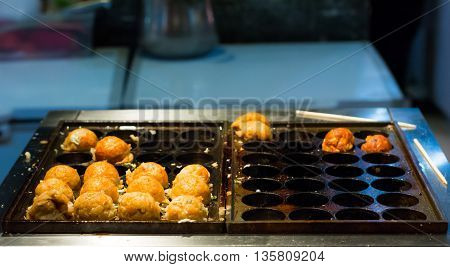 Cooking of Takoyaki one of the most popular food
