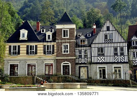 Bai Lu China - October 18 2012: Handsome French-inspired half-timber and stucco houses line a village square  *