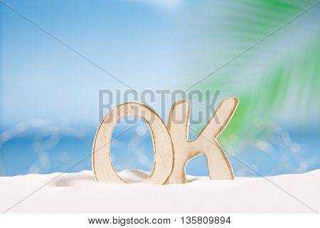 OK word wooden letters with  ocean , beach and seascape, shallow dof