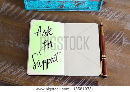 Handwritten Text Ask For Support over notebook, copy space available