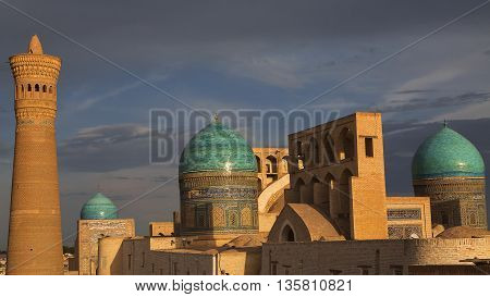 View over the domes and minaret of Poi Kalon Mosque.