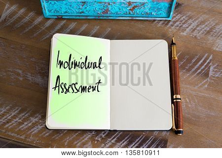 Handwritten Text Individual Assessment over notebook, copy space available
