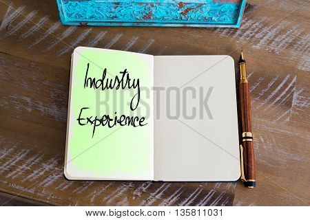 Handwritten Text Industry Experience over notebook, copy space available
