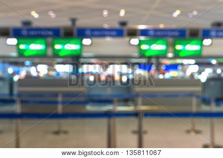 Check-in ticketing counter at international airport - blurred