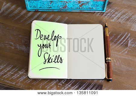 Handwritten Text Develop Your Skills over notebook, copy space available