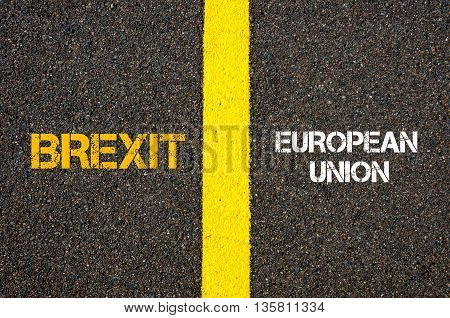 Antonym concept of BREXIT versus EUROPEAN UNION written over tarmac road marking yellow paint separating line between words