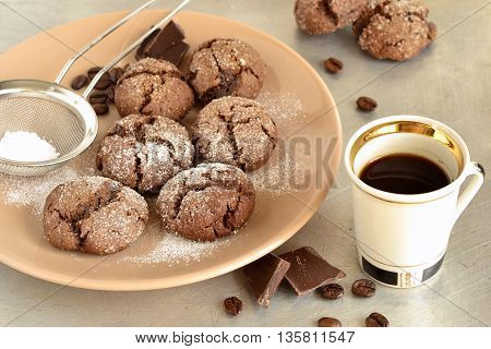 Chocolate cookies with cracks and coffee, selective focus