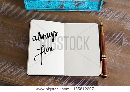 Text Always Fun handwritten over notebook, copy space available
