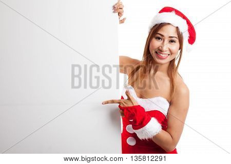 Asian Christmas Girl With Santa Claus Clothes Point To Blank Sign