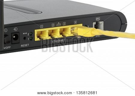foreground of network ports with a network cable connected