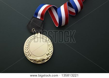 top view of medal on the chalkboard