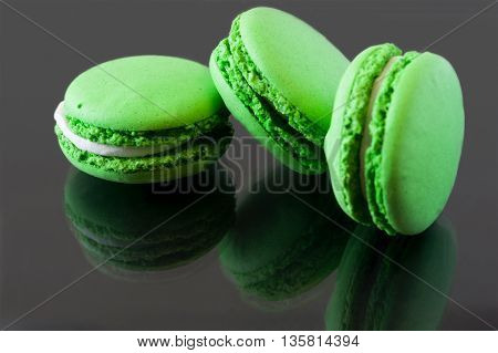 Colorful French Macarons on a dark background