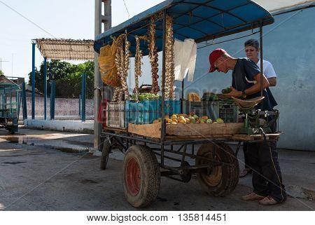 HAVANA, CUBA -JUNE 27, 2015: Cuban street vendor  sold on the street to be fruits and vegetables in Havana city