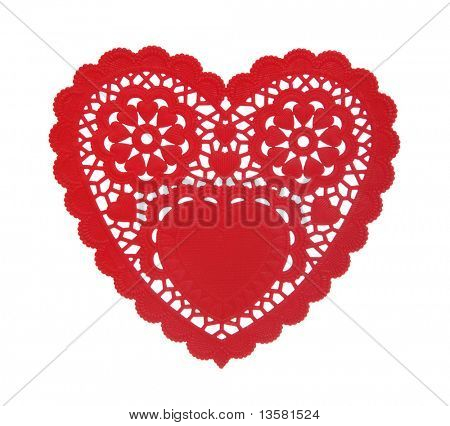 A heart shaped doily isolated over a white background