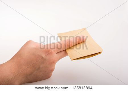 Hand cutting a notebook on a white background