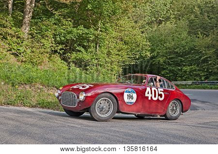 PASSO DELLA FUTA (FI) ITALY - MAY 21: driver and co-driver on the car 1951 Mille Miglia winner Ferrari 340 America Berlinetta Vignale in italian historical race Mille Miglia on May 21, 2016 in Passo della Futa (FI) Italy