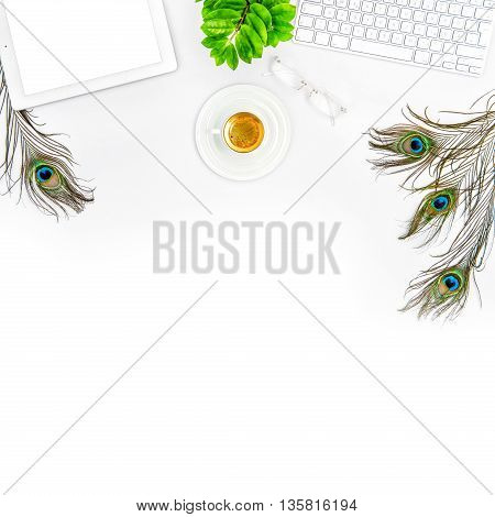 Creative workplace product mockup. Office desk with keyboard tablet pc screen coffee green plant