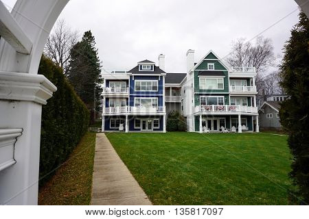 HARBOR SPRINGS, MICHIGAN / UNITED STATES -DECEMBER 24, 2015: A condominium building stands near the Zorn Park Beach in Harbor Springs.