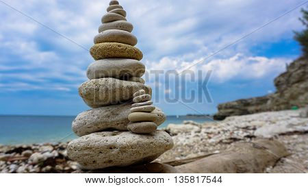 lonely collected pyramid of stone stands proudly on the beach happy their appearance