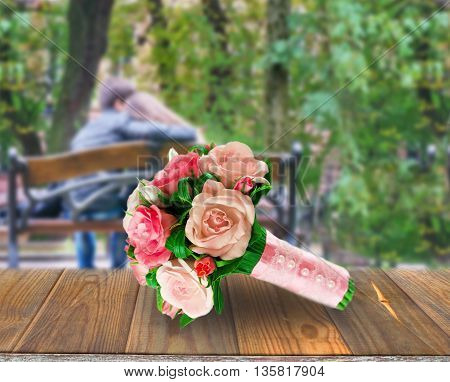 bridal bouquet on the background young couple hugging