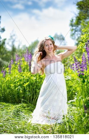 happy pregnant woman relaxing and enjoying life in nature