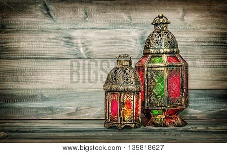 Oriental light lantern. Arabic holidays decoration. Vintage style toned picture