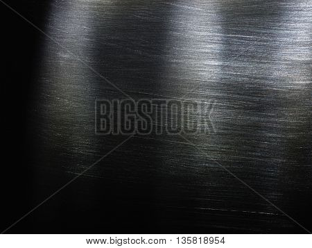 Metal texture background. Macro photo of brushed metal.