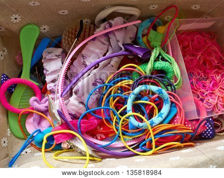 Colorful hair bands and style accessories in a young girl beauty case