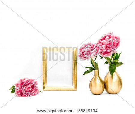 Golden picture frame and peony flowers. Minimal style decoration with space for your image text work