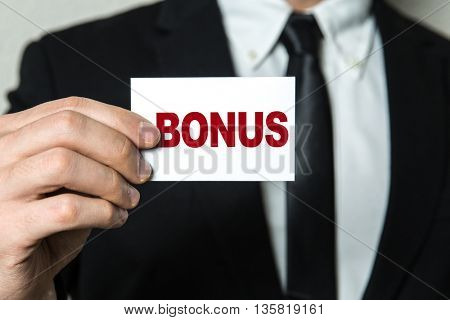 Business man holding a card with the text: Bonus