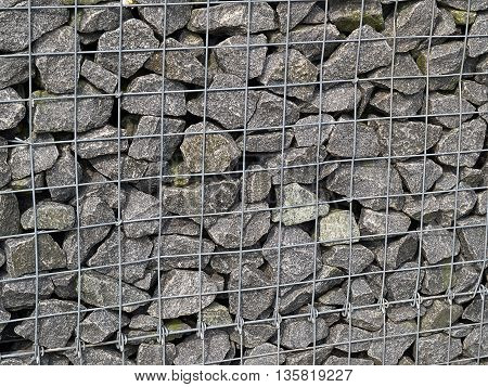 Gabion iron mesh net cage with heavy stones for use in civil engineering and landscaping