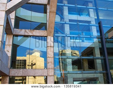 Details of abstract modern design building with glass clad facade