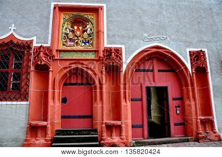 Meissen Germany - May 28 2013: Renaissance doorways painted in a bright coral colour on the Hochstift Meissen Haus