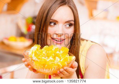 Woman Holds Bowl Full Of Sliced Orange Fruits