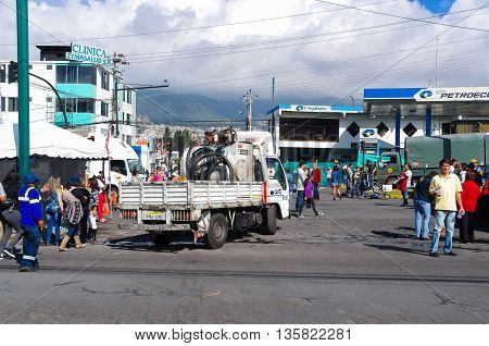 QUITO, ECUADOR - JULY 7, 2015: A gas truck entering near pope Francisco mass event in Ecuador, thousand of people walking on the street.