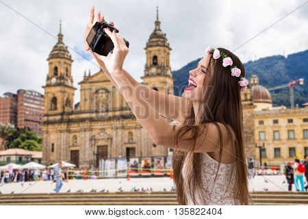 Young brunette girl taking selfie photo in Bogota, Colombia