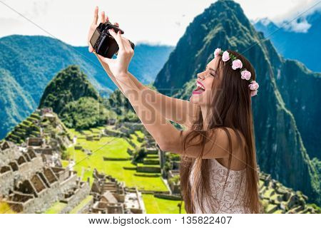 Young brunette girl taking selfie photo in Machu Picchu, Peru