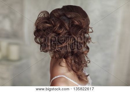 Studio portrait of beautiful bride's hairstyle. Stock photo.