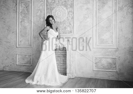 Studio Portrait Of Beautiful Bride With Perfect Hairstyle And Makeup. Black And White