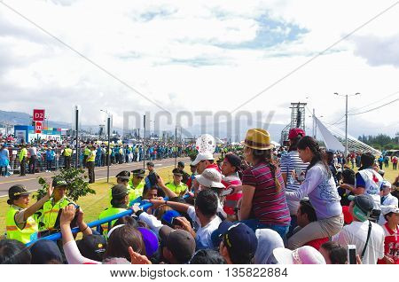 QUITO, ECUADOR - JULY 7, 2015: Police guarding thousand of visitors on pope Francisco mass, round trip of pope on popemobile.