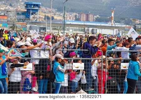 QUITO, ECUADOR - JULY 7, 2015: Thousand of people trying to get a photograph of pope Francisco, little girls and boys.