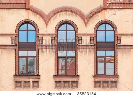 Three windows in a row on facade of St. Petersburg Medical Center front view Russia