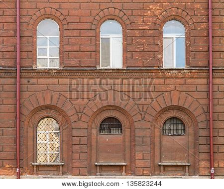 Several windows in a row on facade of St. Petersburg University of the Russian Interior Ministry front view