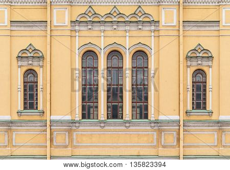 Several windows in a row on facade of the Church of Saint Isidore front view St. Petersburg Russia