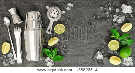 Bar accessories and ingredients for cocktail drink lime mint ice. Alcoholic and nonalcoholic cold drinks