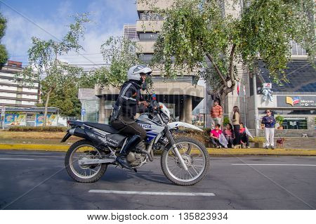 QUITO, ECUADOR - JULY 7, 2015: Police rolling in a motorcycle trough Quito streets, pope Francisco guard.