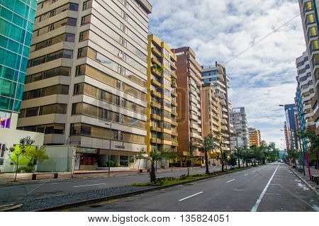 QUITO, ECUADOR - JULY 7, 2015: High and nice buildings in the bussines and commercial street at Quito, sunday.